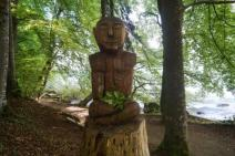 Wooden sculptures along the lakeside walking path
