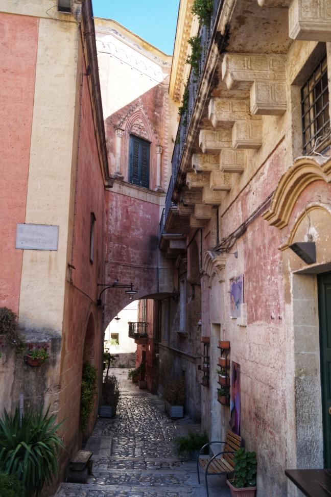 Pink narrow street in Matera Basilicata Italy